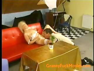 busty blond granny filling her plump fur pie with
