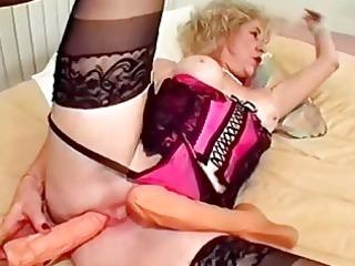 granny dildo copulates her slit