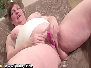 old breasty mom gets large pink fake penis which