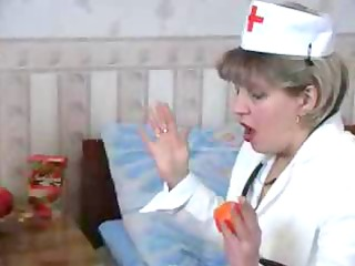 nasty blond granny nurse takes a nip from the