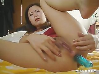 oriental wife with a marital-device