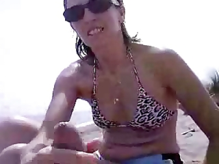 italian wife jerking pounder at public beach