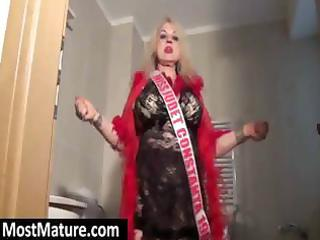 golden-haired granny is doing a slow stripteases