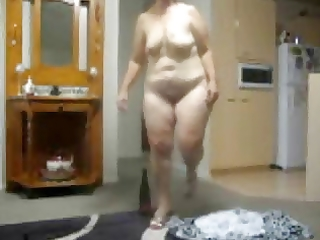 older slut playing with her bottle