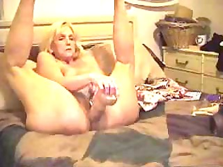 older blondie sticks a monstrous sex toy and her