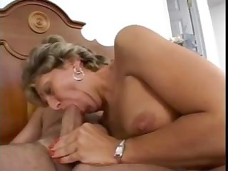 breasty older lady sucks rod and gets her ass