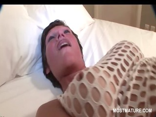 Skinny mature babe pleasing pussy with a dildo