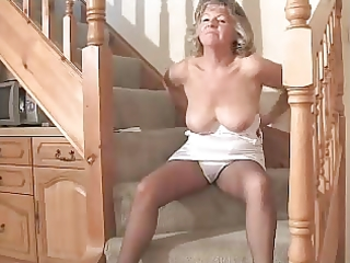 charming granny in dark hose toying on the steps
