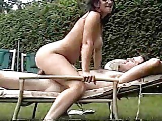 sexy older wife copulates spouse in backyard