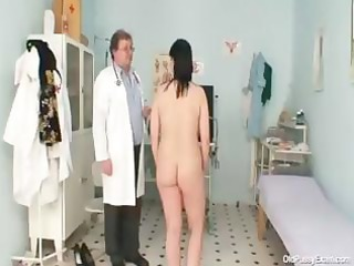 naughty gyno doctor examines the unshaved snatch