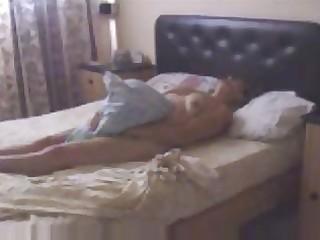 my slutty mum masturbating on sofa caught by