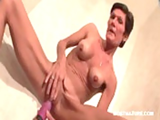 Mature skinny babe dildo fucking her peachy cunt