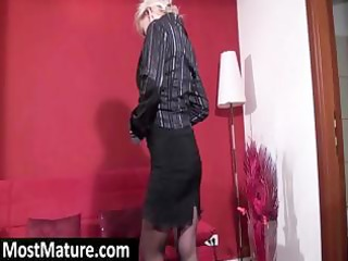 mature blond is putting on a show and taking off