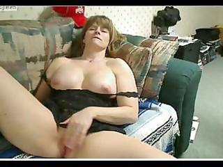 Fat mature female mussing her wet cunt and