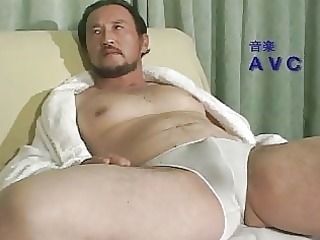 aged oriental lad all alone at home