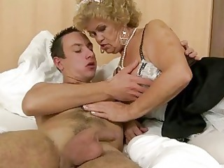 granny in maid outfit fucking with a guy