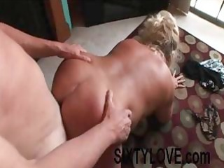 overweight older blond wife receives on her hands