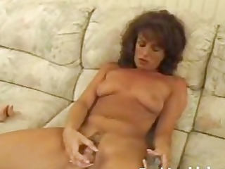 aged hottie toying hirsute pussy