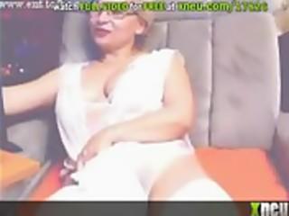 sinful older blonde masturbates wearing white