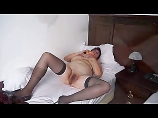 fat mature brunette hair strips and masturbates