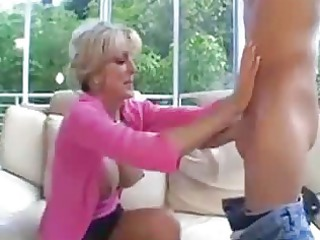 this mature hotties bonks a younger guy on a sofa