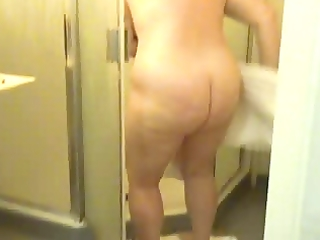 plump soccer mommy getting out of shower