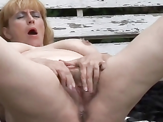 obese older with hairy fur pie outdoors by troc