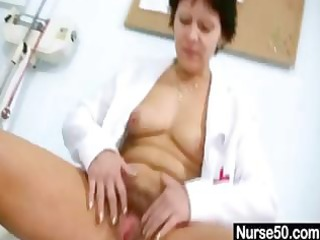 aged dark brown giving a self exam and using tool