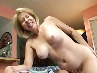 golden-haired granny sucks on dick then acquires