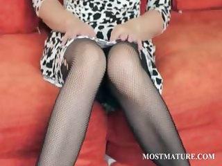older blond playgirl stripping sensually
