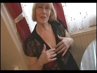 blond granny in hose does a little striptease and