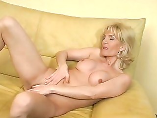 mature blond plays with herself