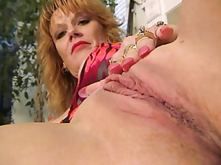 older redhead fingers herself