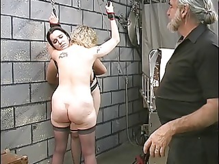 Two cute basement bdsm lesbians make out and get
