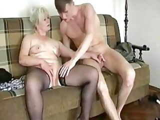obese golden-haired granny seduces a y...