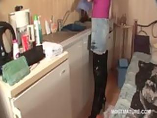 aged wench in boots masturbates in kitchen
